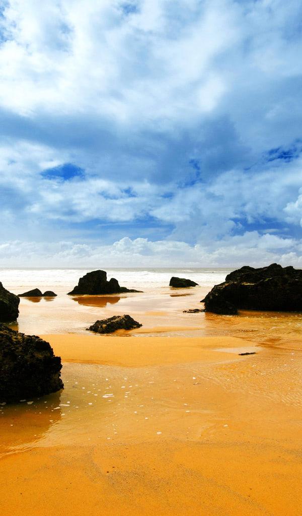 Orange Ocean And Black Rocks Beach Wallpaper
