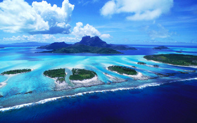 Awesome look on reefs of Bora Bora beach wallpaper