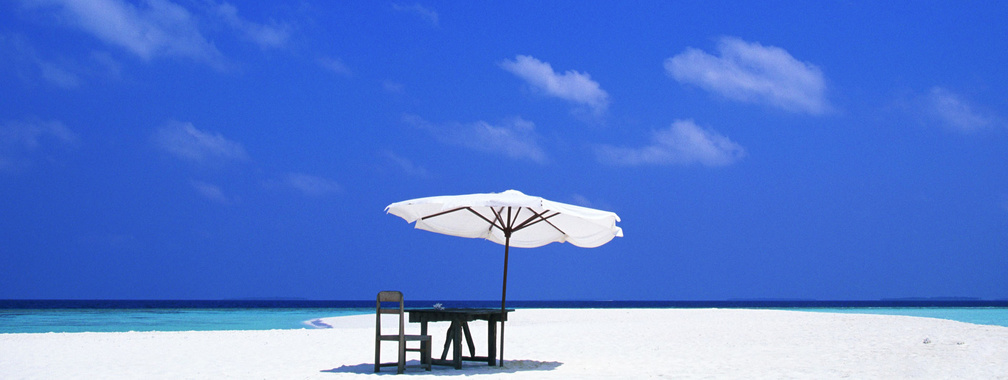 Beach tiki umbrella on sandy beach