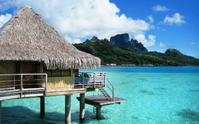 Bora Bora bungalow resort on the beach wallpaper