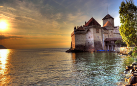 The charming beach of Chillon Castle, Lake Geneva