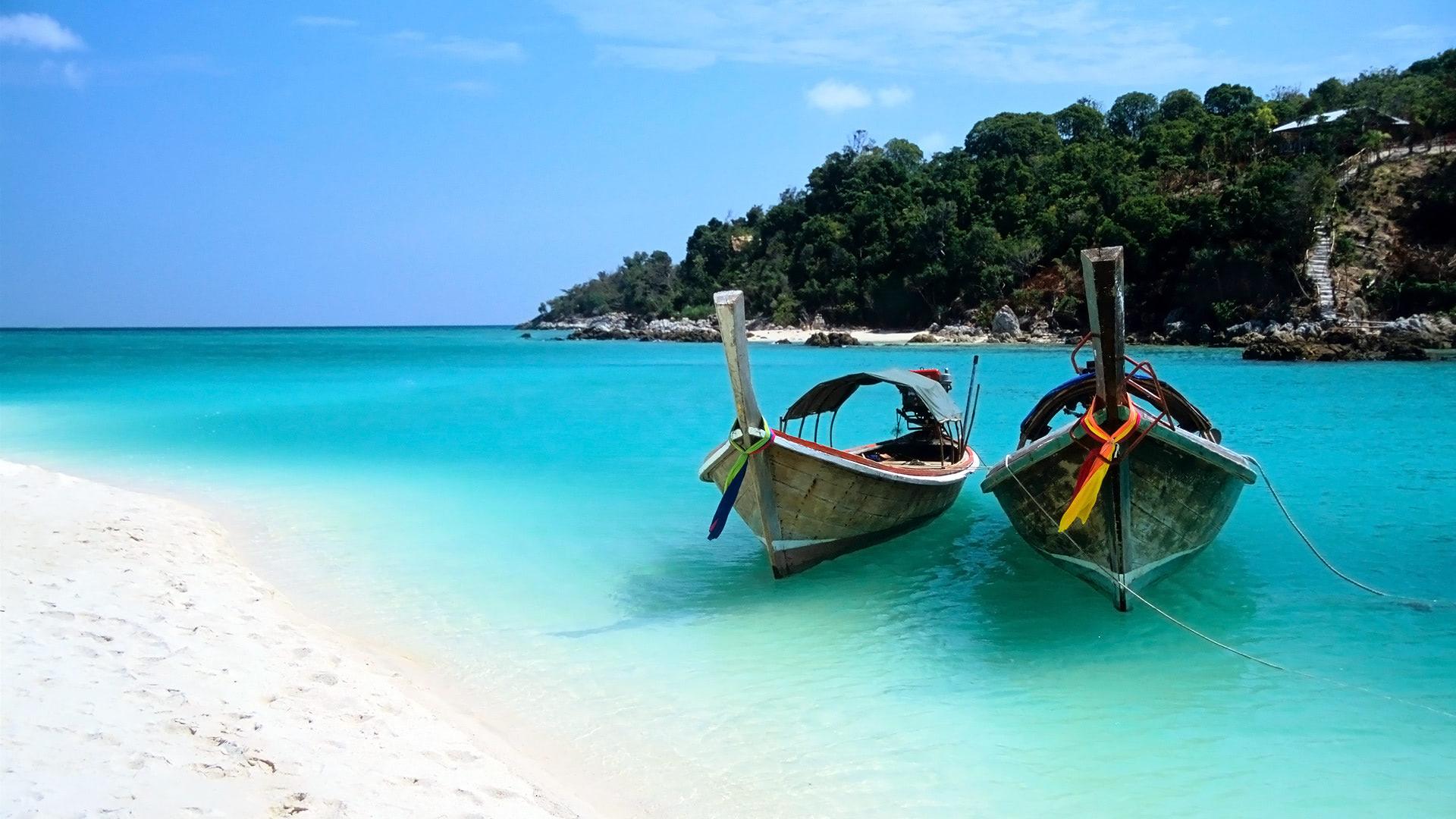 Two Boats On The Beach Of Ko Lipe Island Wallpaper
