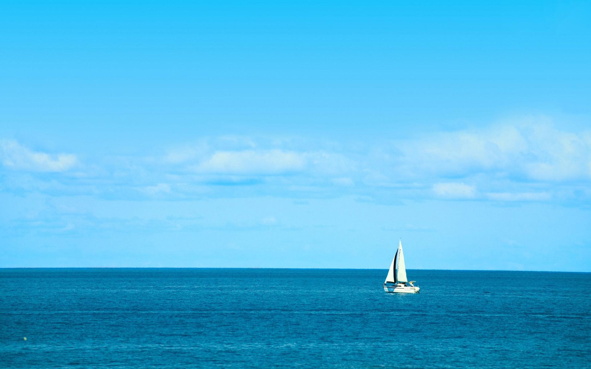white sailboat on blue ocean beach background beach wallpapers