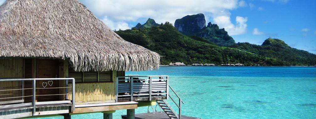 Bora Bora bungalow resort on the beach wallpaper