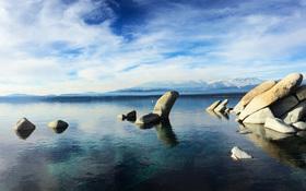 Clear, cobalt blue lake in the snowy Sierra Nevada
