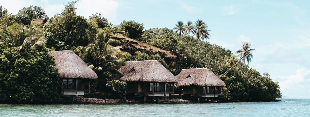 Cozy small bungalows off the coast of French Polynesia
