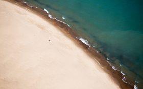 Drone view of sand shoreline in Chicago, Illinois, USA