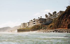 Houses by the beach, surrounded by palm trees at Malibu
