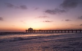 Magical sunset and beautiful waves on Manhattan Beach in California