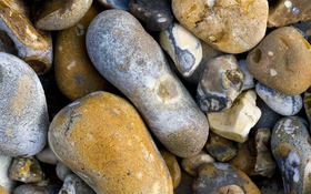 Nice pebbles on the beach background