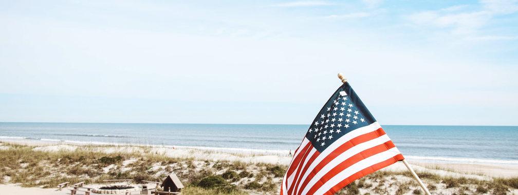 Patriotic flag beside the Atlantic coast in Jacksonville Florida