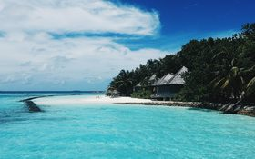 Pristine island and white sandy beach in Gangehi, Maldives