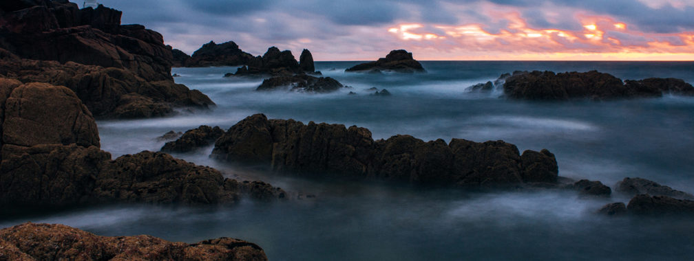 Rocks covered with mist around Corbière Lighthouse, Jersey