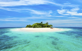 Sandy island in the middle of the ocean wallpaper