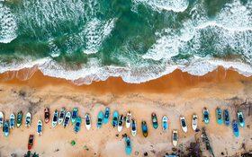 Small boats and great waves at Arugam Bay, Sri Lanka