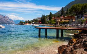Small town Torbole on lake Garda with blue sky in Italy