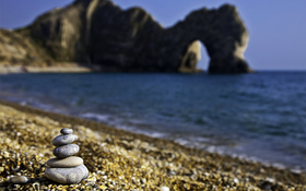 Stones on the sunny beach wallpaper