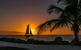 Sunset on a gorgeous beach with a ship sailing at Key West, USA