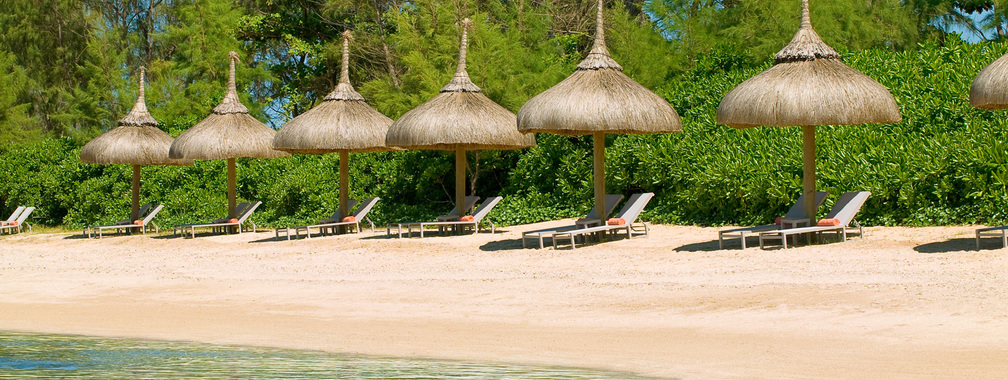Thatched umbrellas on the Mauritius beach