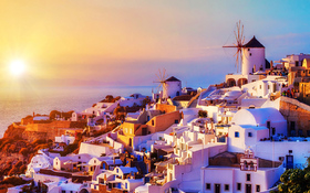 The spectacular sunset over the Oia village in Santorini, Greece