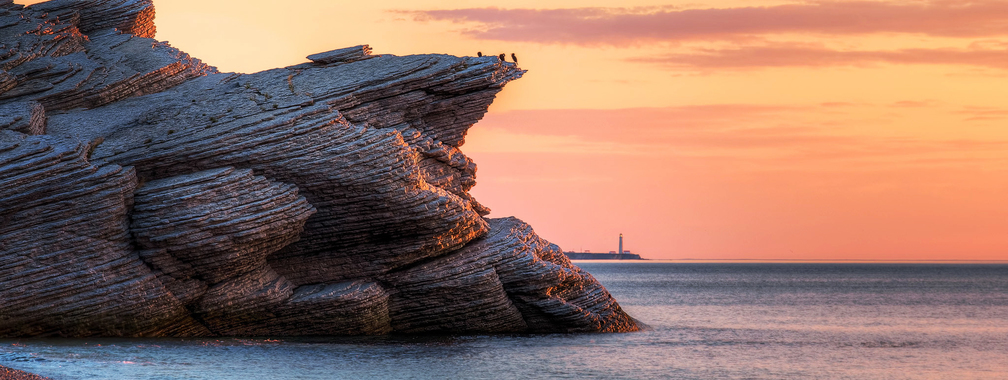 Tranquil sunset over the cliffs of eastern Quebec in Cap Bon Ami, Canada