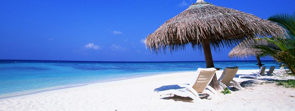 Tropical sandy beach and blue ocean wallpaper