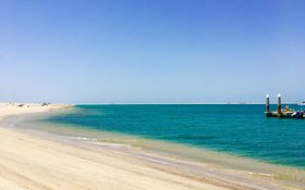 Turquoise waters and soft white sand of Dubai beach