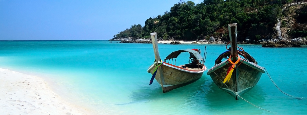 Two boats on the beach of the Ko Lipe island wallpaper