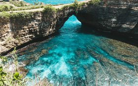 Unique cliff formations and lagoons at Broken Beach in Nusa Penida Island