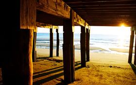 Wooden bridge on the beach background