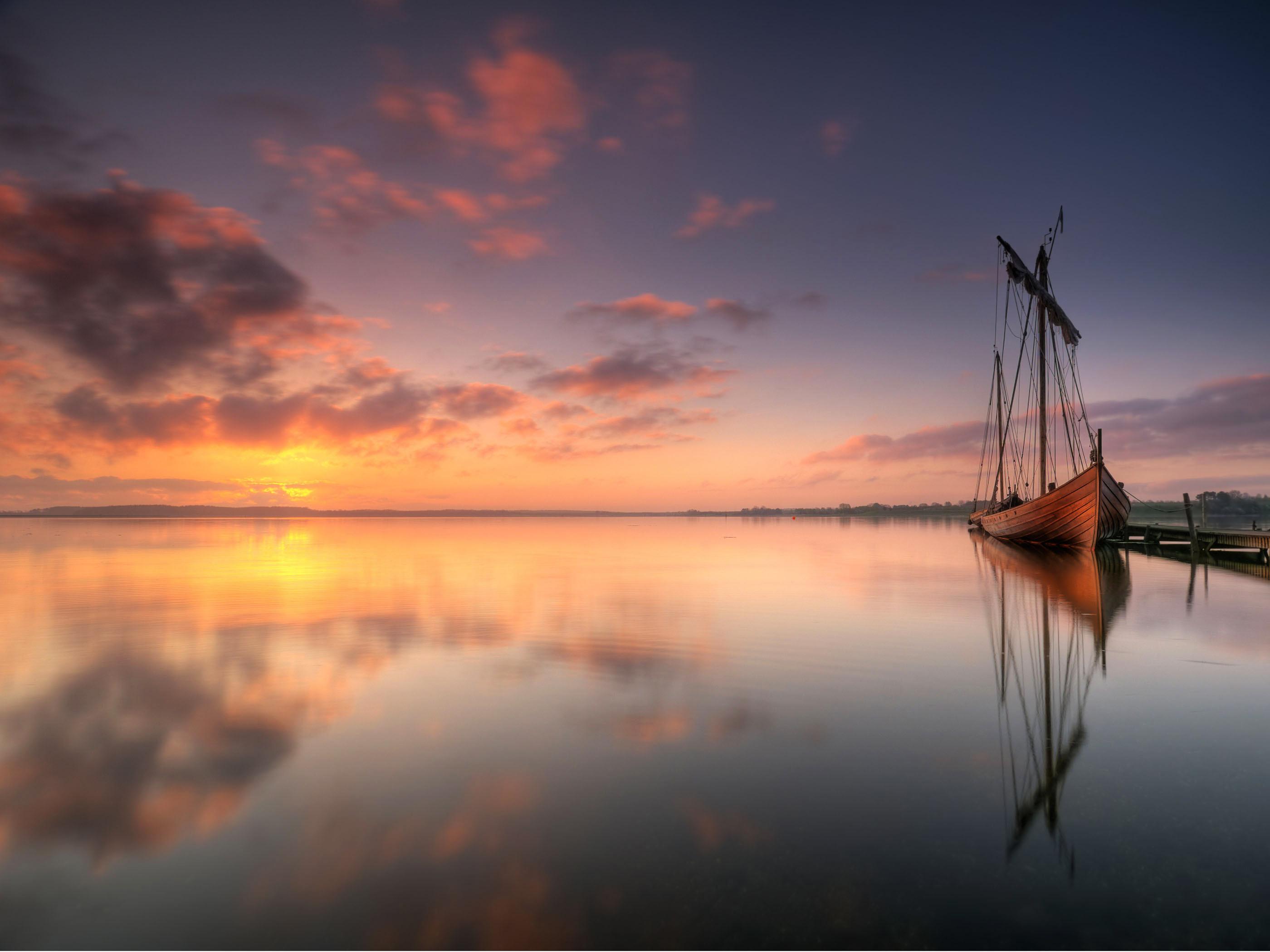 the wallpaper of beautiful viking ship in denmark beach